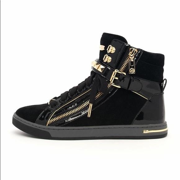 50f3fbd01cc50 Michael Kors gold studded high top black sneakers.  M 5a97754b85e60589e2b66106